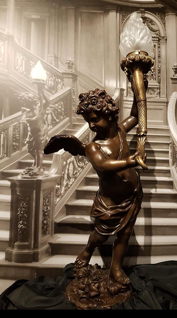 White Star Memories exhibit of the historically accurate bronze replica of Titanic's famous cherub lamp by Alan St. George.