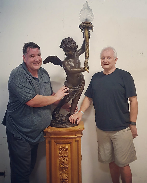 White Star Memories owners John White and David Scott-Beddard with the historically accurate bronze replica of Titanic's famous cherub lamp by Alan St. George.