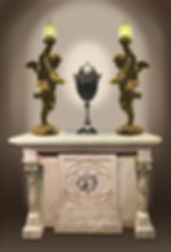 Titanic Memorial design for Alan St George's final resting place.  The cremation urn flanked by full-sized bronze Titanic cherub lamps. The black ceramic urn is decorated with a porcelain gardenia, Mrs St George's favorite flower, and oak leaves, acorns, representing Mr. St. George's favorite tree.