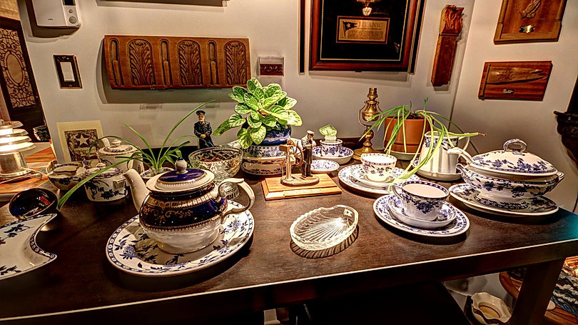 Titanic Room of Stephan Asselin with Titanic china and wood fragments. Captain Smith collectibles are among the porcelain pieces.