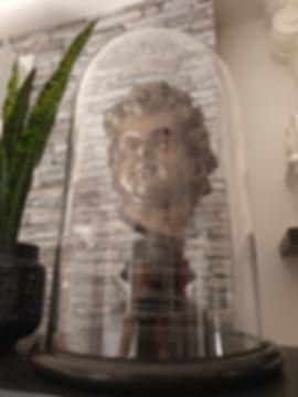 Titanic cherub head by sculptor Alan St George displayed under glass