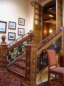 Titanic's pineapple finials matched her nearly identical twin sister ship the Olympic, seen here now decorating a staircase at the White Swan Hotel in Alnwick, England.