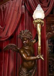 Replica of Titanic's bronze cherub lamp with 24 karat gold torch