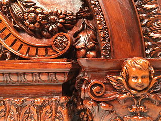 RMS Titanic clock detail shot of the upper section with cherub head capital.