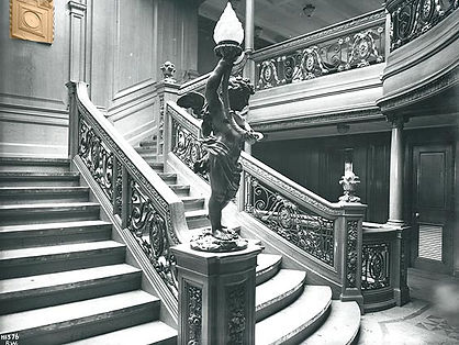 Aft first-class staircase on the Titanic and Olympic ships featured the same style of cherubs as on the forward Grand Staircase, but reversed (mirror image).