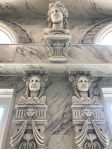 Neoclassical sculptures dominate the Memorial Hall at Havencrest Castle, including historically correct replicas of the caryatids from the RMS Titanic's Dining Saloon
