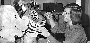 Alan St. George paints a Tiger mascot head in 1972 when Facemakers, Inc., mascots was founded.
