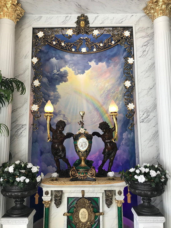 The Titanic Memorial Hall features a pair of full-sized bronze cherubs from the fore and aft Grand Staircase, flanking the cremation urn of Adrianne and Alan St. George.