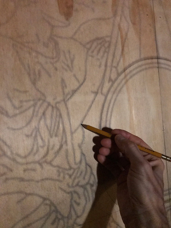 Tracing th archival outline of the RMS Olympic's H&G to the wooden work surface.