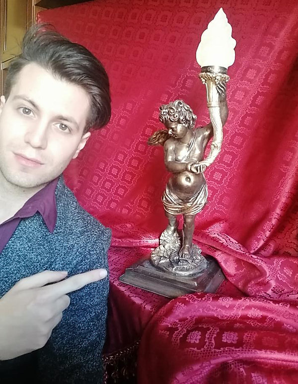 Gabriel Marco Vella, Titanic collector, of Sicily, Italy with cherub lamp replica by Alan St George, USA