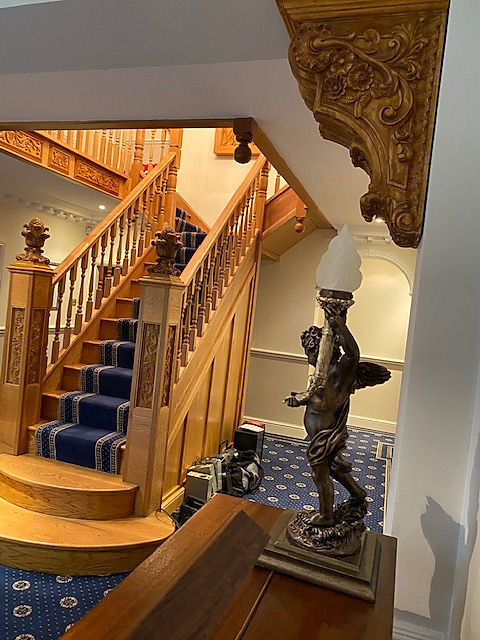 Inspired by Titanic's Grand Staircase, collector Alan Rowland adds some replicas by sculptor Alan St. George to his home's staircase.