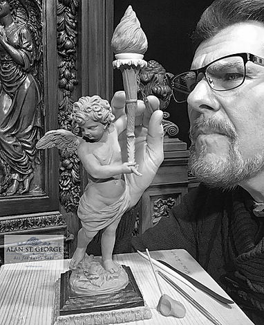 Sculpting the Titanic Cherub. Alan St George puts finishing details on his smallest Titanic cherub sculpture.
