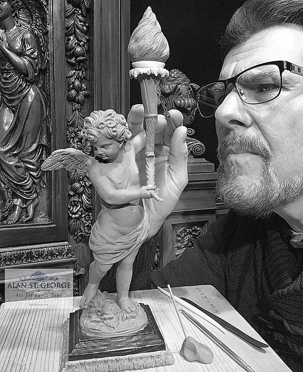 Sculpting the Titanic Cherub. Alan St George puts finishing details on his smallest Titanic cherub sculpture.