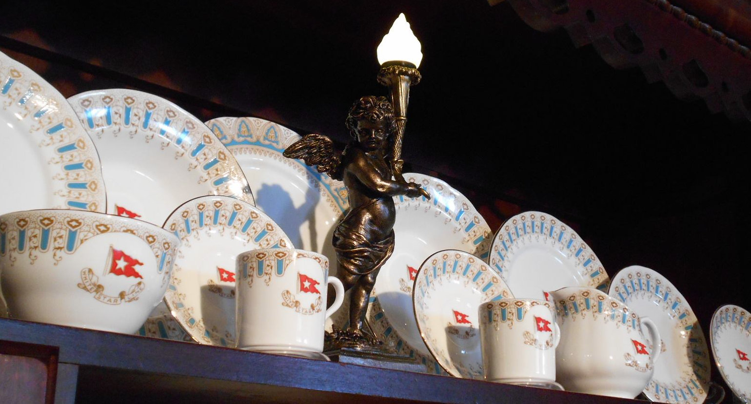 Titanic china collection of Sohny Desrosiers with small scale Tianic cherub replica in the middle.