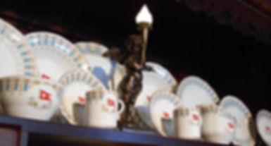 Titanic china collection of Sohny Desrosiers with small scale Tianic cherub replica in the middle.