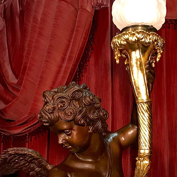 Detail of full-sized bronze Titanic cherub with 24 karat gold torch