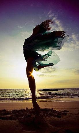 woman free at beach.jpg
