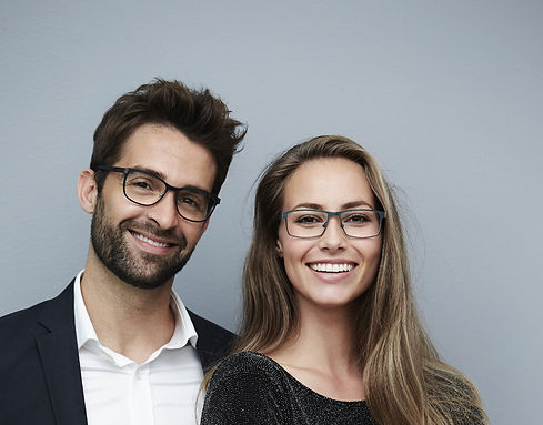 Glamorous couple smiling for camera_edit