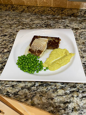 Pan Fried Halibut with Boulangere Potatoes, Spiced Cauliflower Puree and Peas