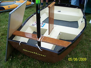 A very small dinghy with its daggerboard raised