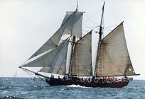 A square-rigged topsail on a gaff schooner