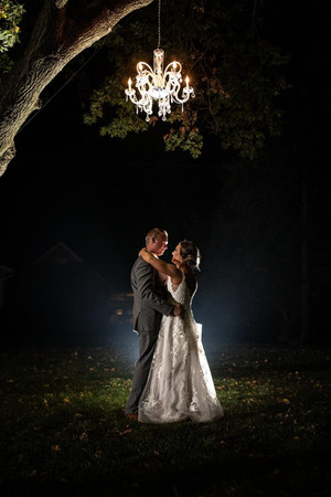 Bride-groom-chandelier-blue-heron-barn