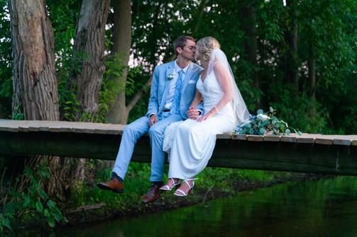 bride-groom-kiss-bridge.jpg
