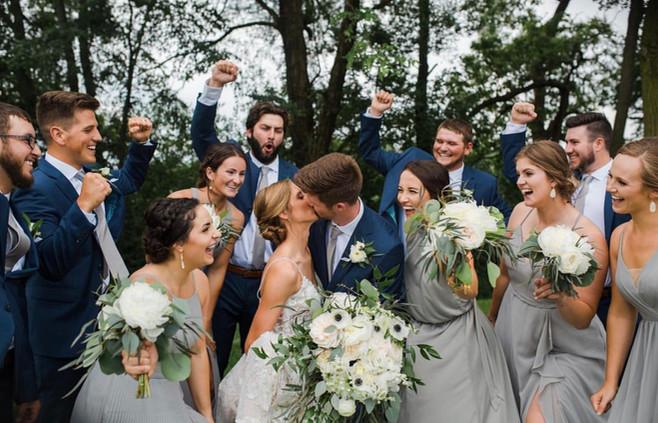 bride-groom-kissing-bridal-party