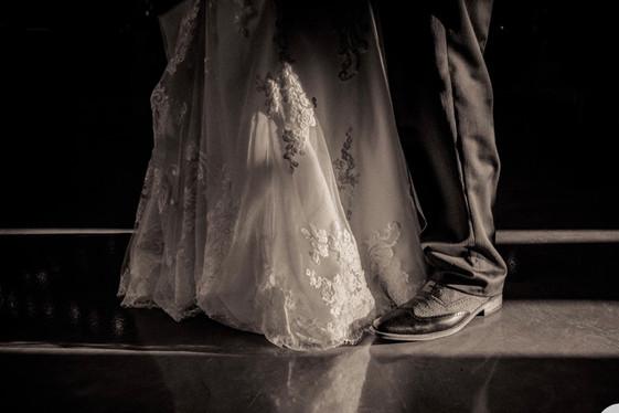 Bride-groom-shiny-floor-blue-heron-ba