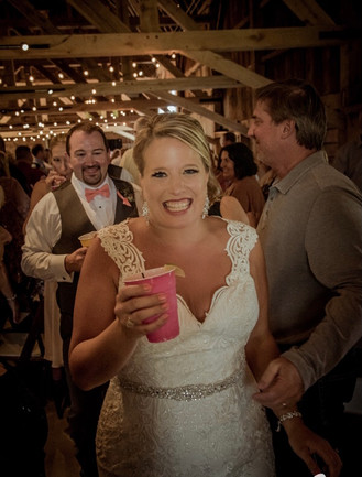bride-smiling-blue-heron-barn.jpeg