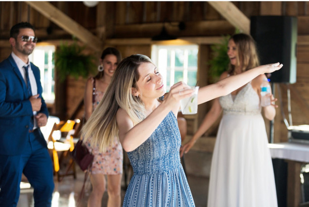 girl-dancing-reception-blue-heron-barn
