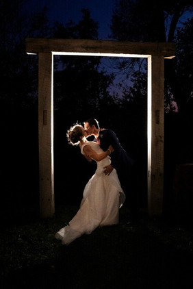 barn-wood-wedding-arbor-bride-groom.jpeg