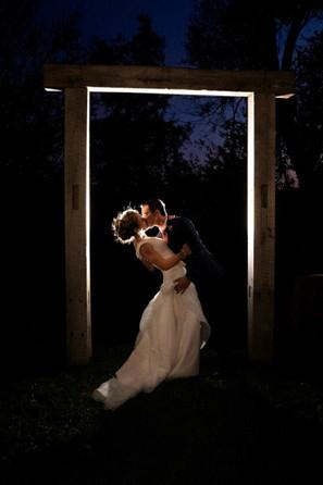 barn-wood-wedding-arbor-bride-groom.jpeg