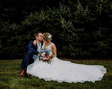Bridge-groom-kiss-pine-tree-blue-heron-barn