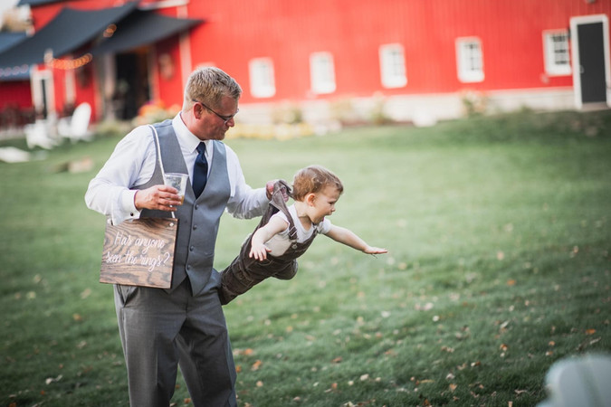 Boy-father-flying-blue-heron-barn