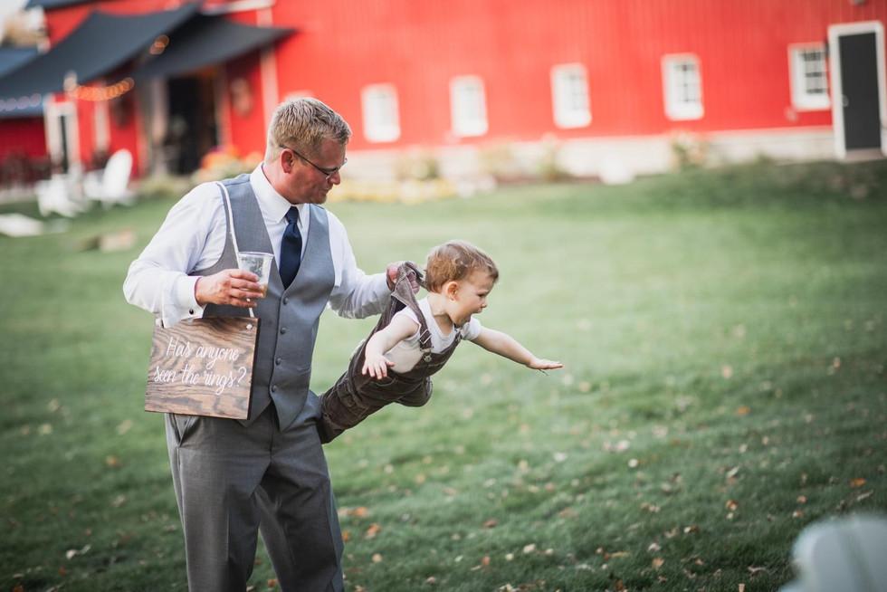 Boy-father-flying-blue-heron-barn