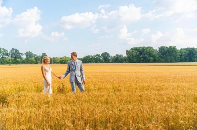 bride-groom-hay-field-blue-heron-barn.jp