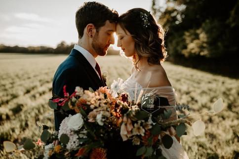 bride-groom-sunset-field-blue-heron-barn