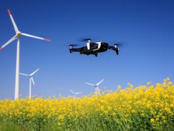 Drone surveying wind farm