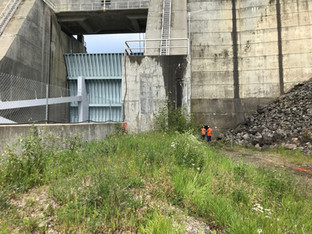 Surveyors on site of dam construction