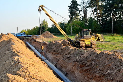 Surveyor on site of pipeline construction