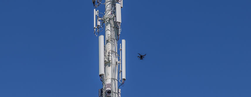 Drone survyeing cell tower