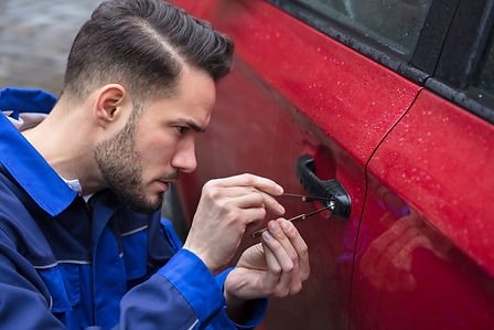 Young Man Opening Red Car Door With Lock