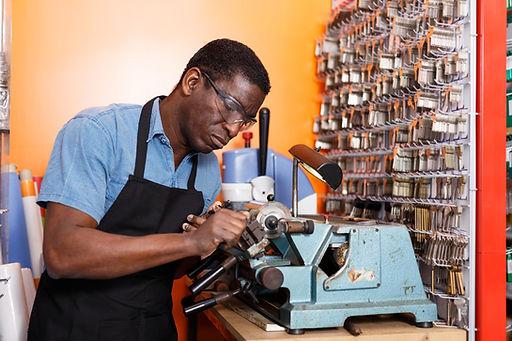 Focused locksmith working on key duplica
