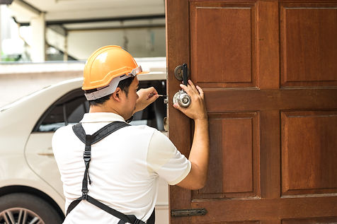locksmith with safety helmet try to inst