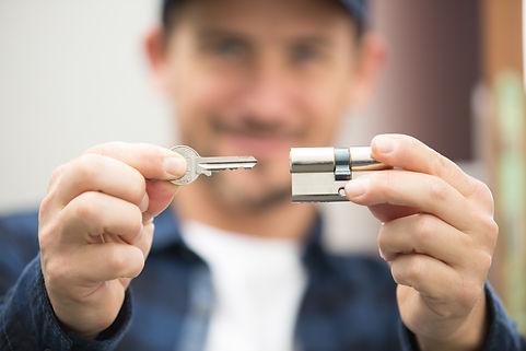 closeup locksmith fix a wood lock.jpg