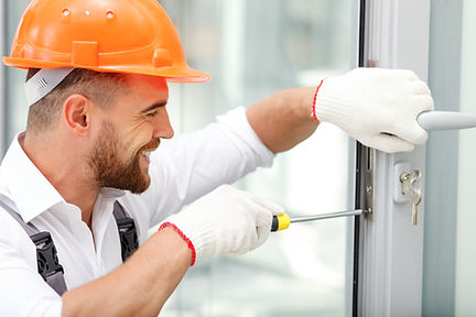 Attractive young builder is installing l