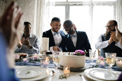 Gay Couple Hands Cutting Wedding Cake.jp