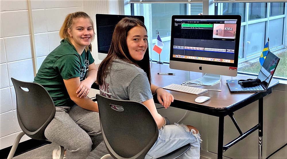 Students Taylor Henderson (left) and Jocelyn Kirk, who helped put the new video together.