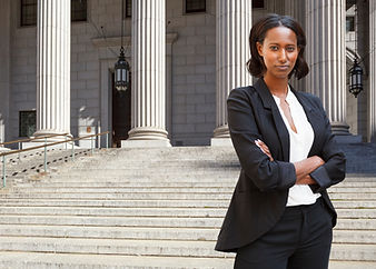 A female lawyer (or business person) sta
